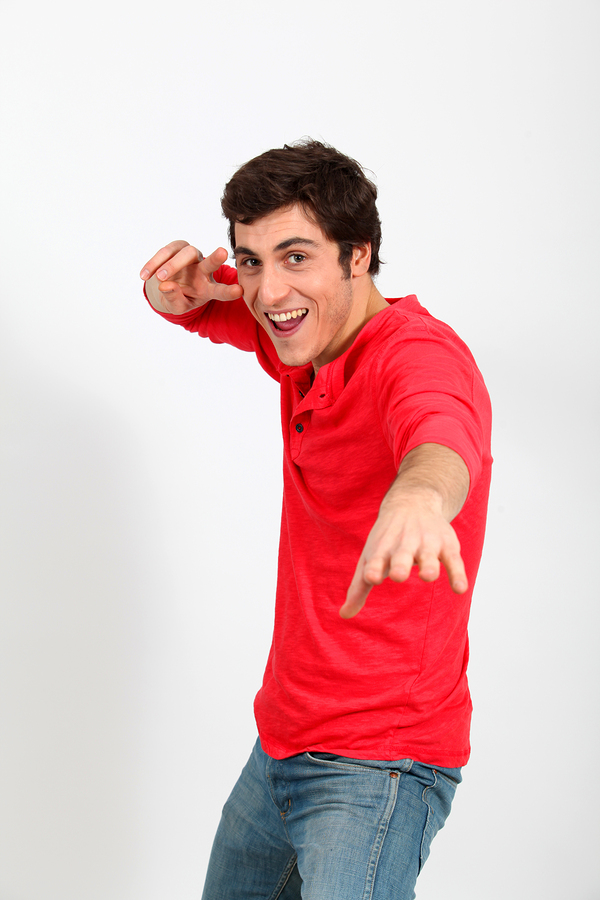 Bigstock-Man-in-red-shirt-standing-on-w-17006312